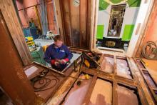 man repairing a train car from the inside